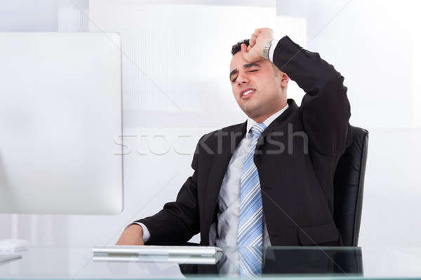 Frustrated Businessman Sitting At Computer Desk Stock photo © AndreyPopov