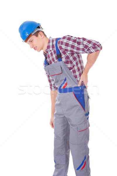 Férfi munkás szenvedés hátfájás fiatal fehér Stock fotó © AndreyPopov
