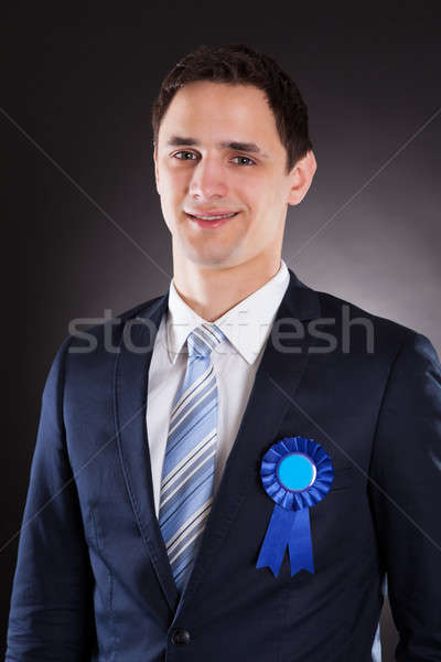Handsome Businessman Wearing Blue Ribbon Stock photo © AndreyPopov