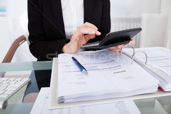 Businesswoman Calculating Bills Stock photo © AndreyPopov