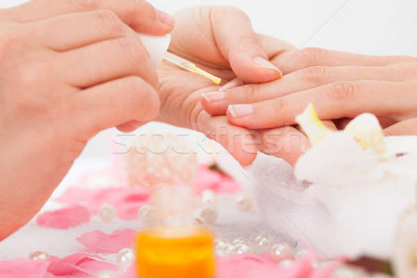 Manicurist Applying Nail Varnish Stock photo © AndreyPopov