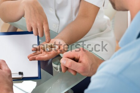 Doctor Checking Glucose Level In Diabetic Patient Stock photo © AndreyPopov