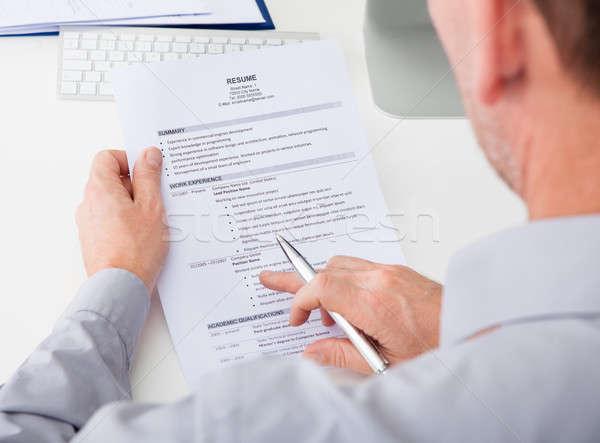 Man Holding Curriculum Vitae Stock photo © AndreyPopov