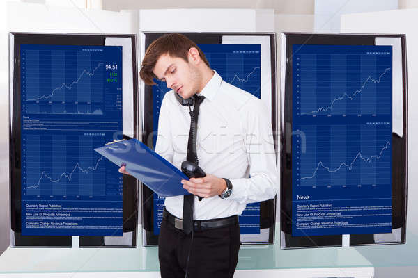 Stock Broker Working At Office Stock photo © AndreyPopov