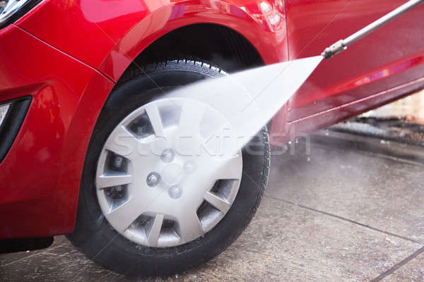 Hose Splashing Water On Black Tire Stock photo © AndreyPopov