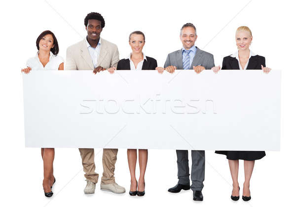 Stock photo: Multiethnic Business People Holding Large Billboard