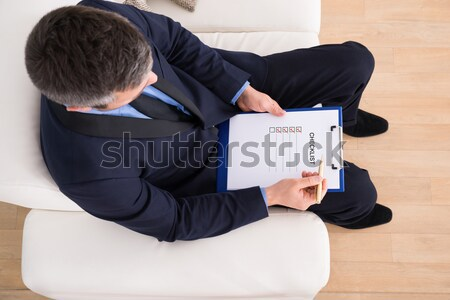 Businessman Filling Checkboxes Stock photo © AndreyPopov