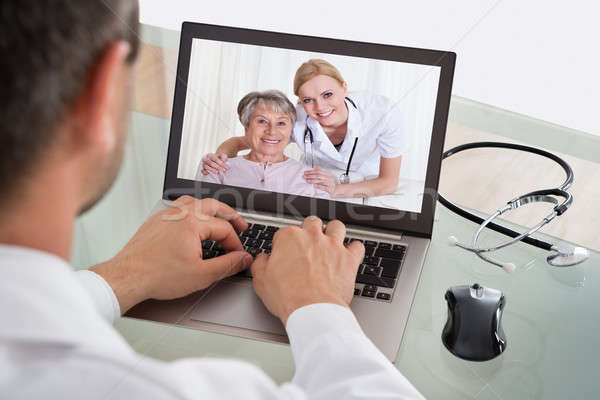 Doctor Video Chatting With Nurse And Patient Stock photo © AndreyPopov