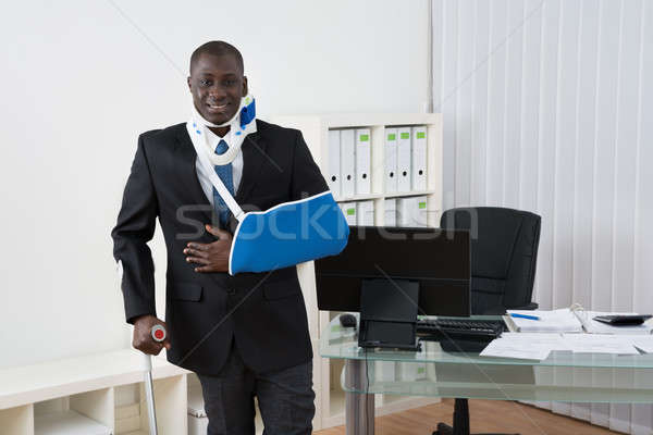 Businessman With Injuries In Office Stock photo © AndreyPopov