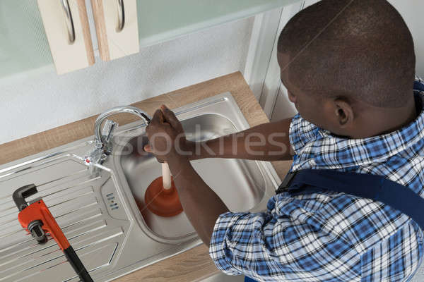Plumber Cleaning Sink With Plunger Stock photo © AndreyPopov