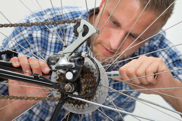 Man Repairing Bicycle Stock photo © AndreyPopov