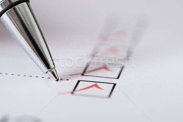 Pen Over Filled Checkboxes Stock photo © AndreyPopov