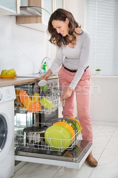 Woman Removing Cup From Dishwasher Stock photo © AndreyPopov