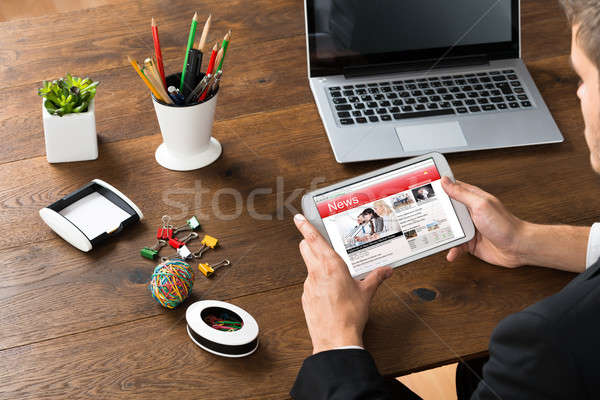 Stock photo: Businessman Reading News On Mobile Phone