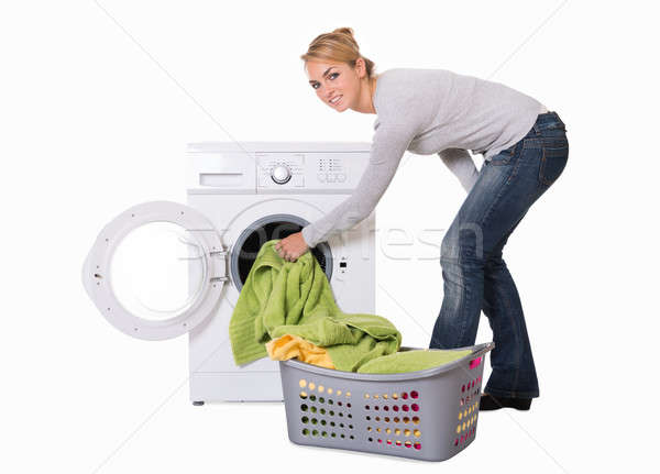 Woman Loading Washing Machine Stock photo © AndreyPopov