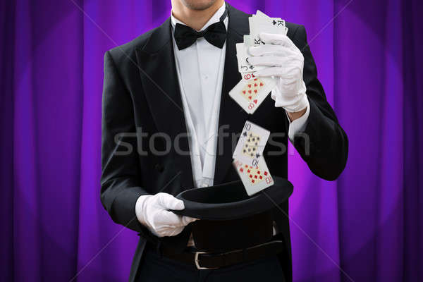 Stock photo: Midsection Of Magician Performing Trick With Cards And Hat
