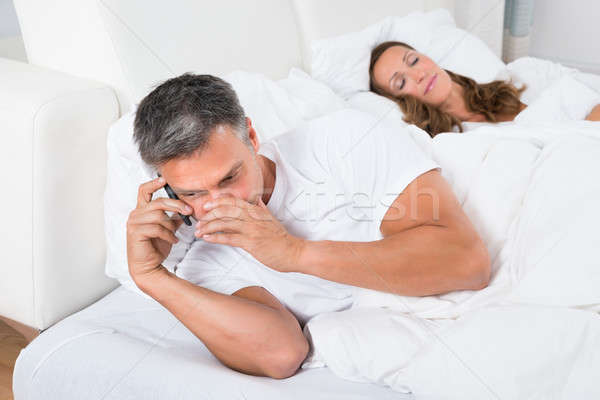 Man Busy On Phone While Woman Sleeping Stock photo © AndreyPopov