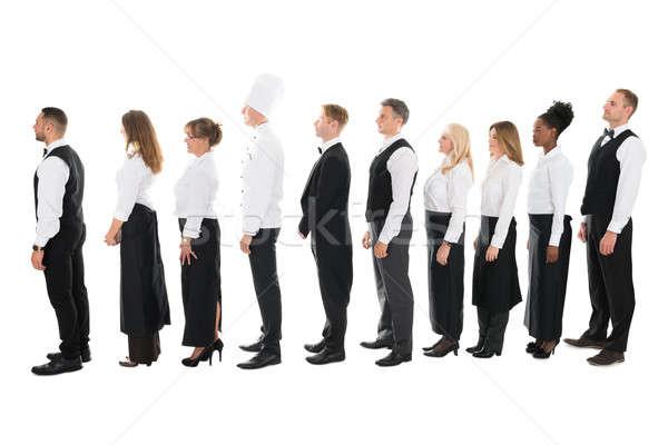 Stok fotoğraf: Yandan · görünüş · restoran · personel · ayakta · hat · tam · uzunlukta