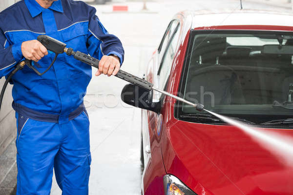 Worker Cleaning Car With Jet Sprayer At Service Station Stock photo © AndreyPopov