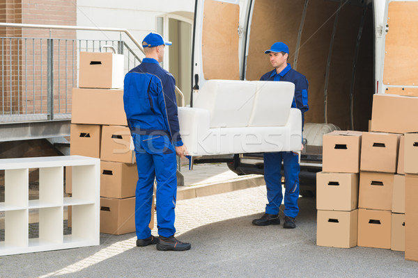 Movers Carrying Sofa Outside Truck On Street Stock photo © AndreyPopov