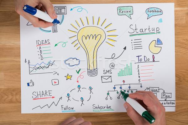 Businessmen Making Strategy At Desk Stock photo © AndreyPopov