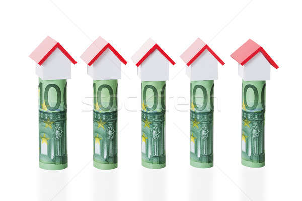 House Models Arranged On Rolled Euro Notes Stock photo © AndreyPopov