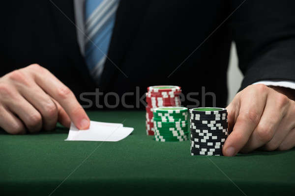 Poker joueur main cartes puces Photo stock © AndreyPopov