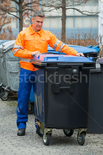 Working Man Standing Near Dustbin On Street Stock photo © AndreyPopov