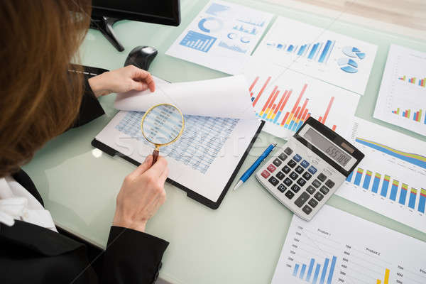 Businesswoman Looking At Financial Report Stock photo © AndreyPopov