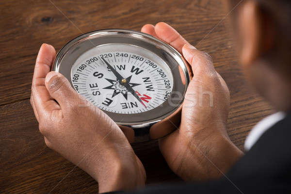 Businessperson Hand Holding Compass Stock photo © AndreyPopov