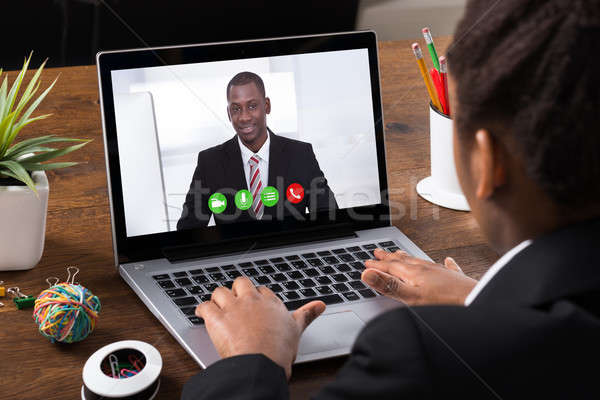 Businesswoman Video Conferencing On Laptop Stock photo © AndreyPopov