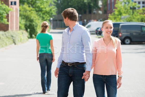 Man Walking With His Girlfriend Looking At Another Woman Stock photo © AndreyPopov