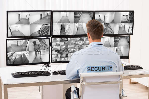 Security Guard Monitoring Multiple CCTV Footage Stock photo © AndreyPopov