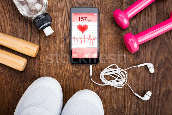 Exercise Equipment On Wooden Floor Stock photo © AndreyPopov