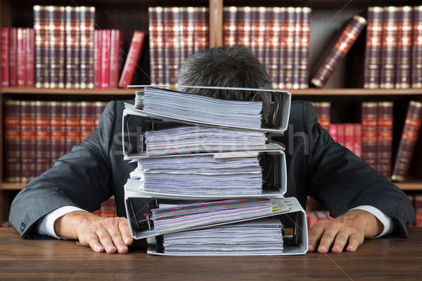 Lawyer Leaning On Stacked Folders In Courtroom Stock photo © AndreyPopov