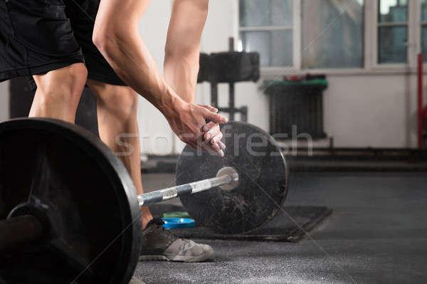 Weightlifter Hand Applying Talc Powder Stock photo © AndreyPopov