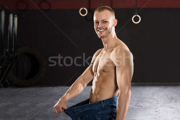 Man Wearing Loose Jean In The Gym Stock photo © AndreyPopov