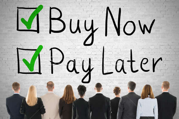 People Looking At Buy Now Pay Later Concept Stock photo © AndreyPopov