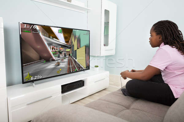Girl Playing Video Game With Joysticks Stock photo © AndreyPopov