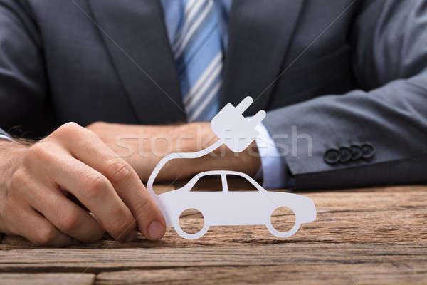 Imprenditore carta auto elettrica tavola tavolo in legno Foto d'archivio © AndreyPopov