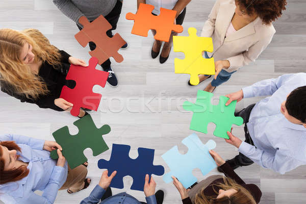 Stock photo: Group Of Business People Holding Colorful Jigsaw Puzzles