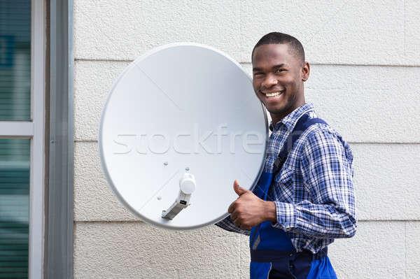 Heureux Homme technicien tv portrait Photo stock © AndreyPopov