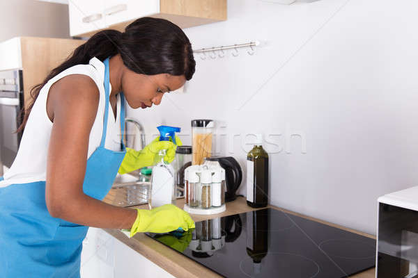 Housewife Cleaning Induction Stove Stock photo © AndreyPopov