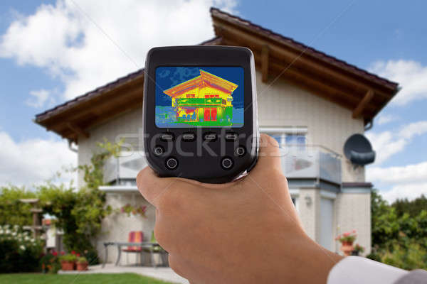 Person Detecting Heat Loss Using Infrared Thermal Camera Stock photo © AndreyPopov