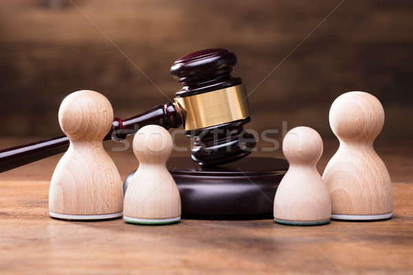 Separation Of Pawn Wooden Figure In From Of Gavel Stock photo © AndreyPopov