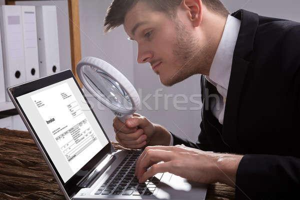 Businessman Analyzing Bill On Laptop Stock photo © AndreyPopov