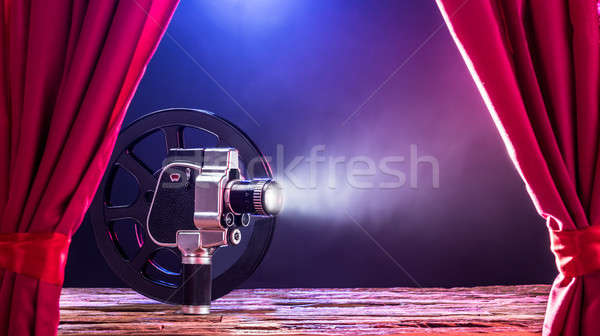 Movie Camera And Film Reel On Stage Stock photo © AndreyPopov