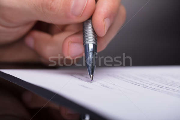 Businessperson Signing Document Stock photo © AndreyPopov