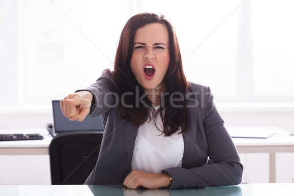 Portrait Of A Angry Businesswoman Stock photo © AndreyPopov