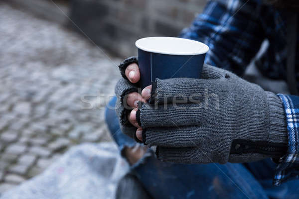 Mendiant jetable tasse main Photo stock © AndreyPopov